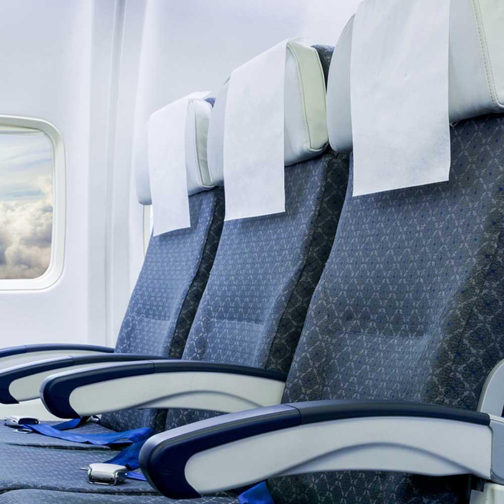Подголовник для кресла самолета
